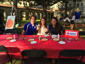 Roland Johnson, Maria Muzaurieta, and Grace Calavan at a Bolles HS Red Cross Club Event
