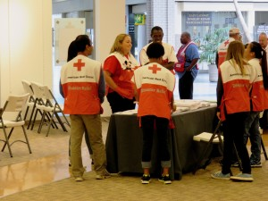 Fort Jackson VolunTEEN coordinators Mary Reardon and Cliff Klaye chat with teens ready to welcome people to a Multi Agency Resource Center in Columbia, South Carolina. (Photo credit: Carl Manning/American Red Cross)