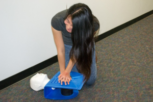 Catherine, a volunteer at the American Red Cross, teaches CPR/ First Aid.