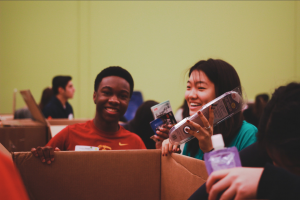 "At the Houston Food Bank, Will Acheampong and Rachel Shen package household goods. ""I realized just how many people were food insecure,"" Shen said. ""It really allowed me to see how fortunate I am to have all the food that I am blessed with."""